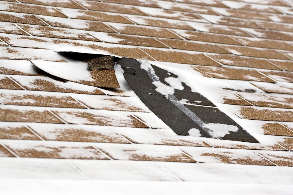 Roof shingle damage from cold weather.